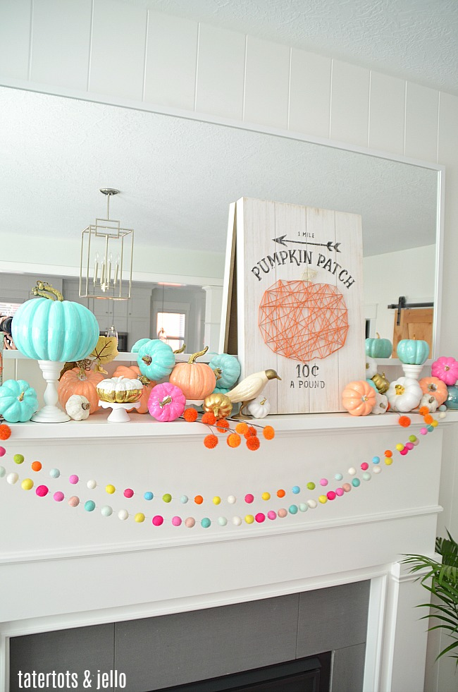 Colorful Fall Mantel with Painted Foam Pumpkins. Paint inexpensive pumpkins bright colors for a unexpected colorful fall mantel!