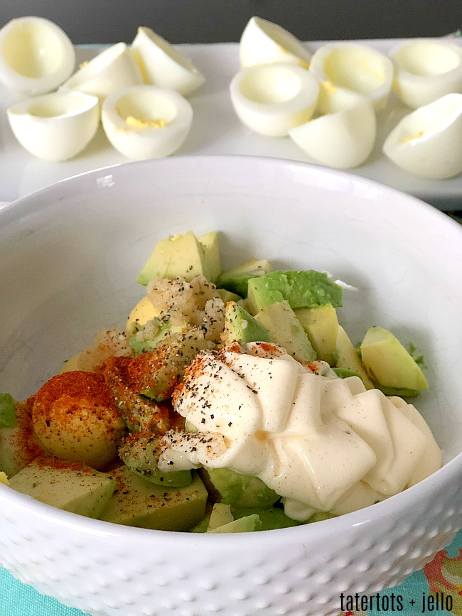 Spicy Avocado Deviled Eggs are a zesty twist on traditional deviled eggs. Filled with creamy avocado and egg yolks, plus spiced and topped with sliced jalapenos, these eggs will be the star of your spring brunch!