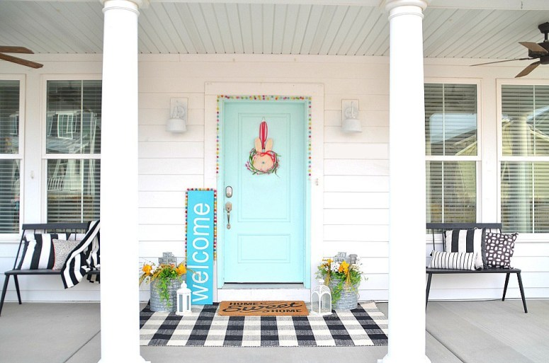 Spring porch iwth bunny sign and giant welcome sign.