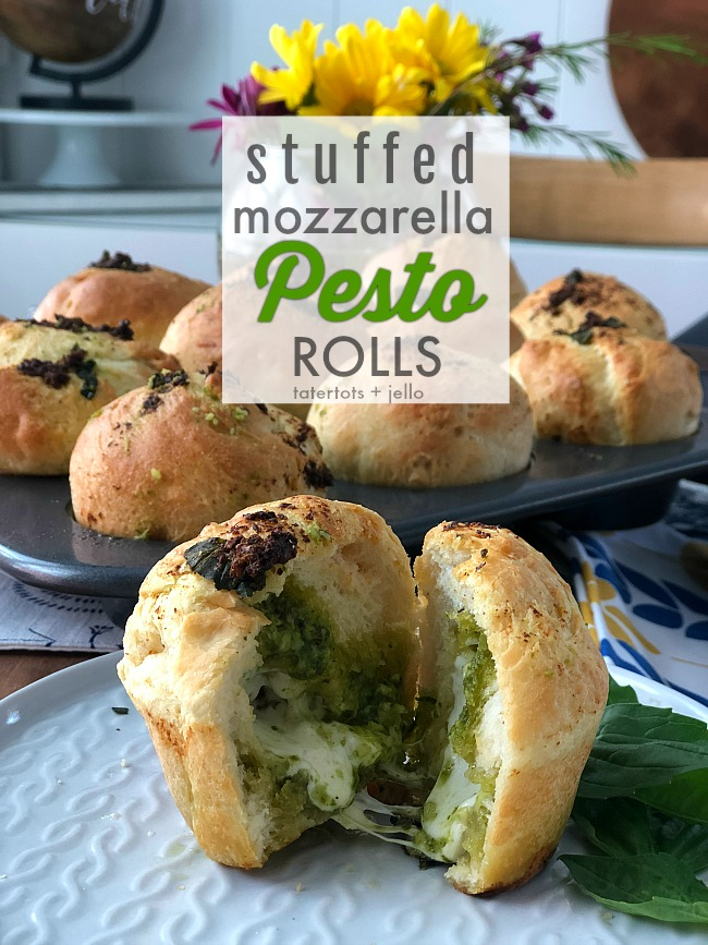 Stuffed Cheesy Mozzarella Pesto Rolls are an easy recipe to whip up using pre-made Rhodes dough. Warm fragrant rolls are stuffed with gooey Mozzarella and Parmesan cheese, pesto and basil. It's the perfect compliment to an Italian Dinner OR a great lunch on it's own!