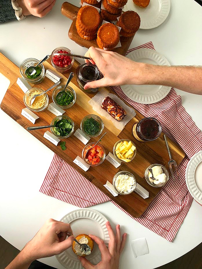 New Holiday Appetizer -- Southern-Style Cornbread Crostinis with Topping Bar! Your guests will love building their own cornbread costinis with this easy recipe and buffet idea!