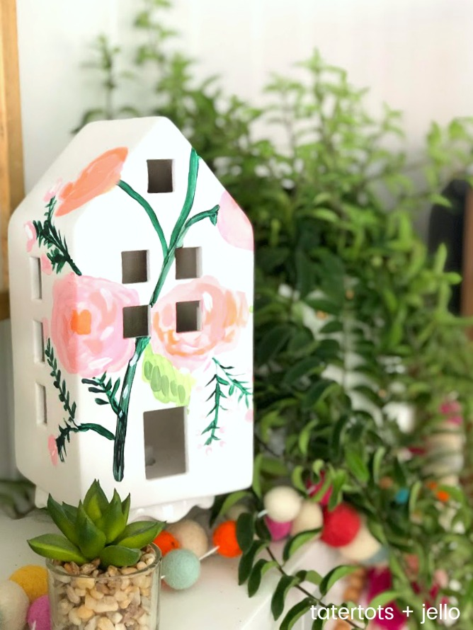 Spring Anthropologie-Inspired Painted Houses. Get your home ready for Spring by painting these cute white houses. You can add them to a shelf or mantel for your home!