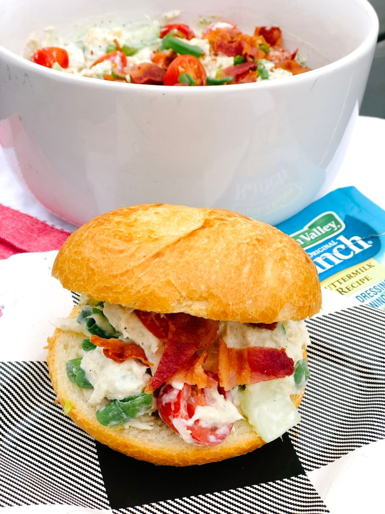 Healthier BLT Ranch Chicken Salad is perfect to make for Summer inside a sandwich or on top of a bed of greens! Tangy ranch sauce and tender shredded chicken blend perfectly with crisp celery, onions and tomatoes topped with a sprinkle of crunchy bacon. It takes a BLT up a notch!