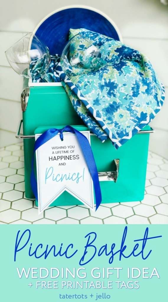 Picnic Basket Wedding Gift Idea and Free Printable Tag. Looking for the perfect wedding or newlywed gift? A picnic basket filled with a handy picnic blanket, plates and glasses and a cute printable tag is something the happy couple will use for years to come!