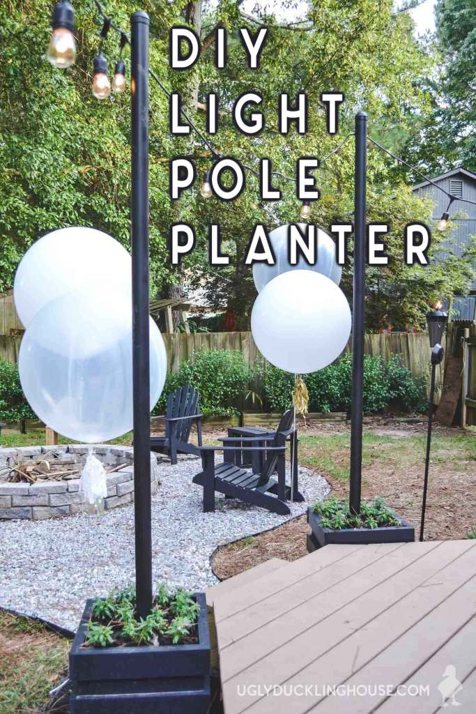 DIY Outdoor Light Pole Planters @ Ugly Duckling House