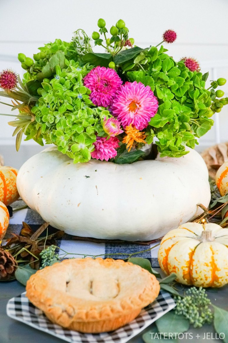 How to make a live pumpkin floral centerpiece. Create a gorgeous natural fall tablescape with a live pumpkin and fresh flowers.