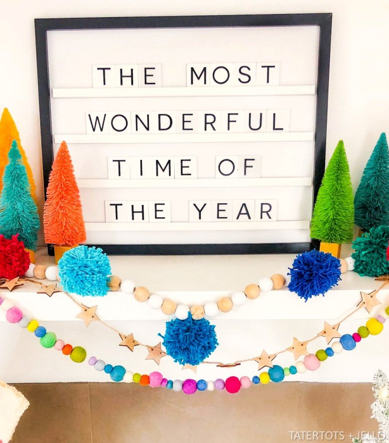 Farmhouse Wood Bead and Pom Pom Garland. Create a beautiful garland for the holidays or all winter long with yarn and beads.