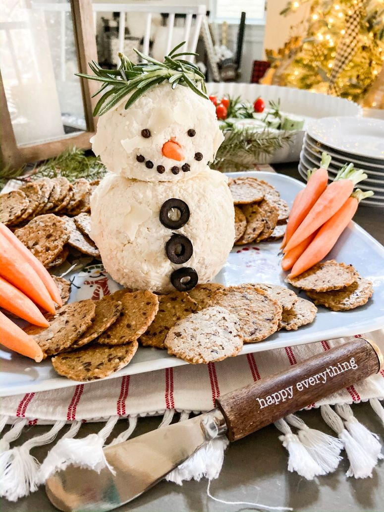 15-Minute Snowman White Cheese Ball Recipe. Mozzarella, cream cheese, Worchesterchire sauce and spices rolled in shaved Parmesan cheese. Divide the cheese ball into two parts and make it into a delightful snowman that will be the hit of any holiday or Winter party!