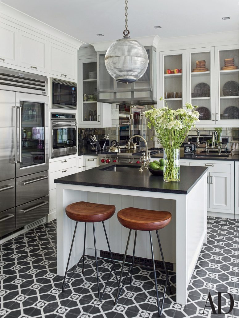 Crisp black and white kitchen tile at apartment therapy