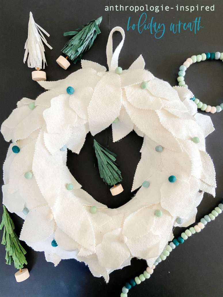 Anthropologie-Inspired Holiday Felt Wreath. Create a whimsical holiday wreath with layers of fluffy wool, felted balls and adorable tissue paper trees.