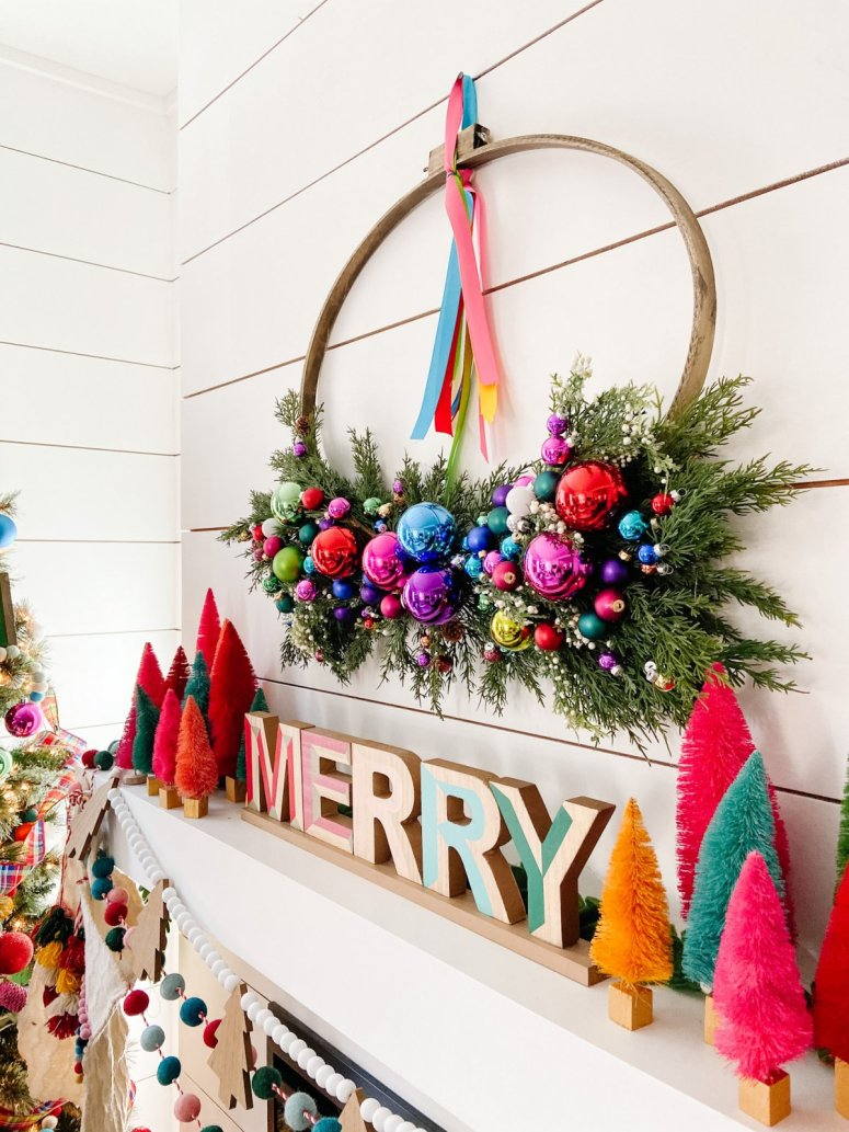 Bright Colorful Merry Mantel. Create colorful holiday cheer with a bright garland, little bottlebrush trees and an embroidery hoop ornament wreath!