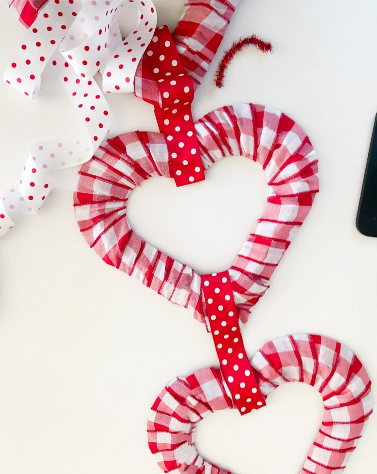 Dollar Store Triple Heart Valentine's Day Wreath. Brighten up February with an inexpensive and triple dollar store heart wreath.
