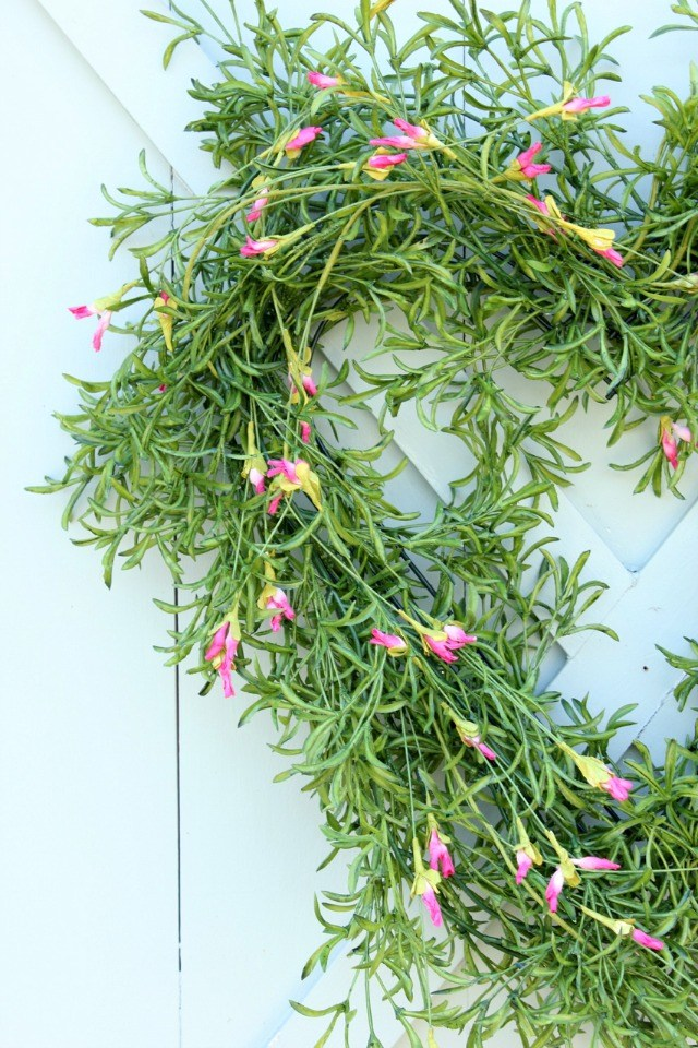 How to Make a Greenery Heart Wreath. Start the year off fresh with a gorgeous faux greenery heart wreath!