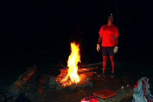 Dave stoking the fire at camp...Also, last known photo of my original seatcushion...Sigh...Sure gonna miss that seat cushion, we've been through so much together!!!