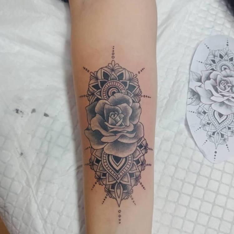Mandala with rose long forearm tattoo