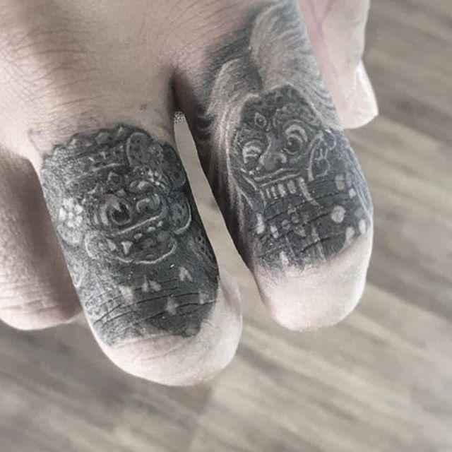 Barong and rangda finger tattoos by Ipin Latattu