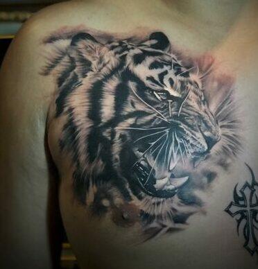 growling tiger chestpiece by onal seminyak tattooer