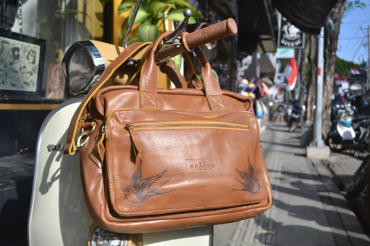 Swallow tattoos on Bali leather bag inked by Gunz for Tattlas
