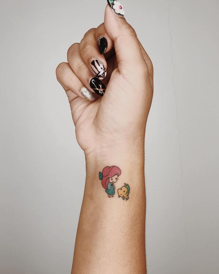 Small color wrist tattoo of Ariel and Flounder by Ilo, March 2020 - Canggu, Bali