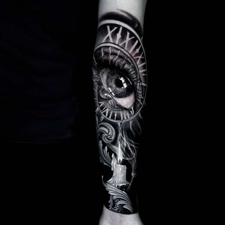 realistic eye tattoo in black and white sleeve by Ata Ink