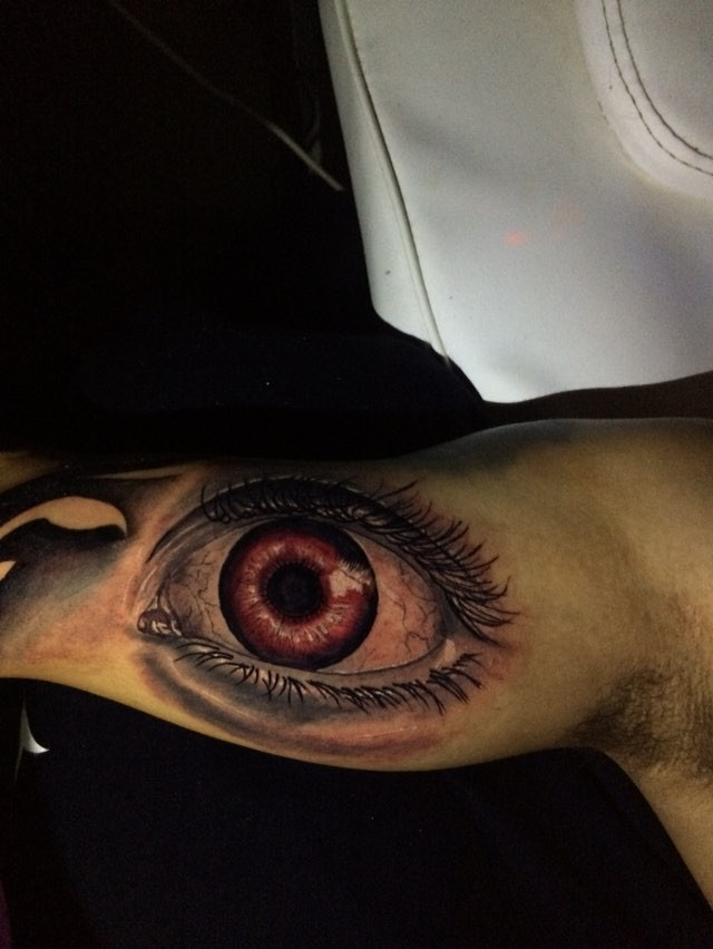 Brown eye tattoo by Andri for Diamond Dog Tattoo Shop