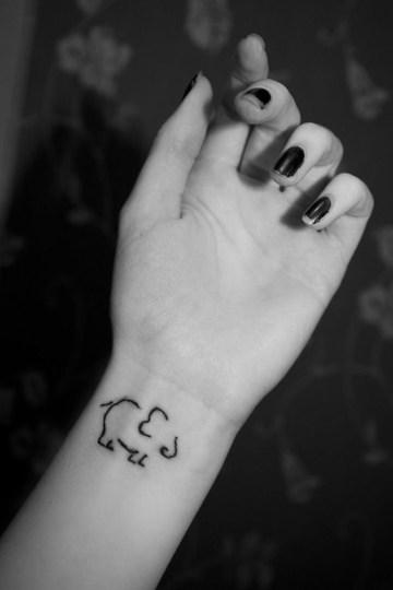 Elephant Outline Wrist Tattoo