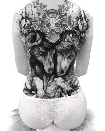 Dark horses back tattoo