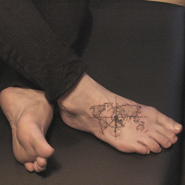 World map tattoo on foot by Lindsay April