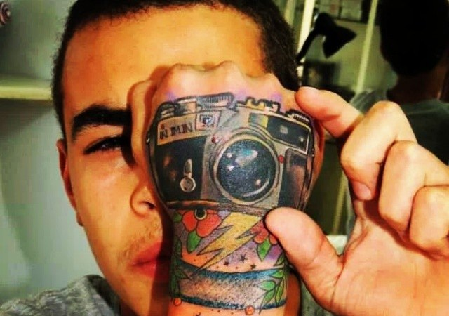 camera tattoo on men wrist