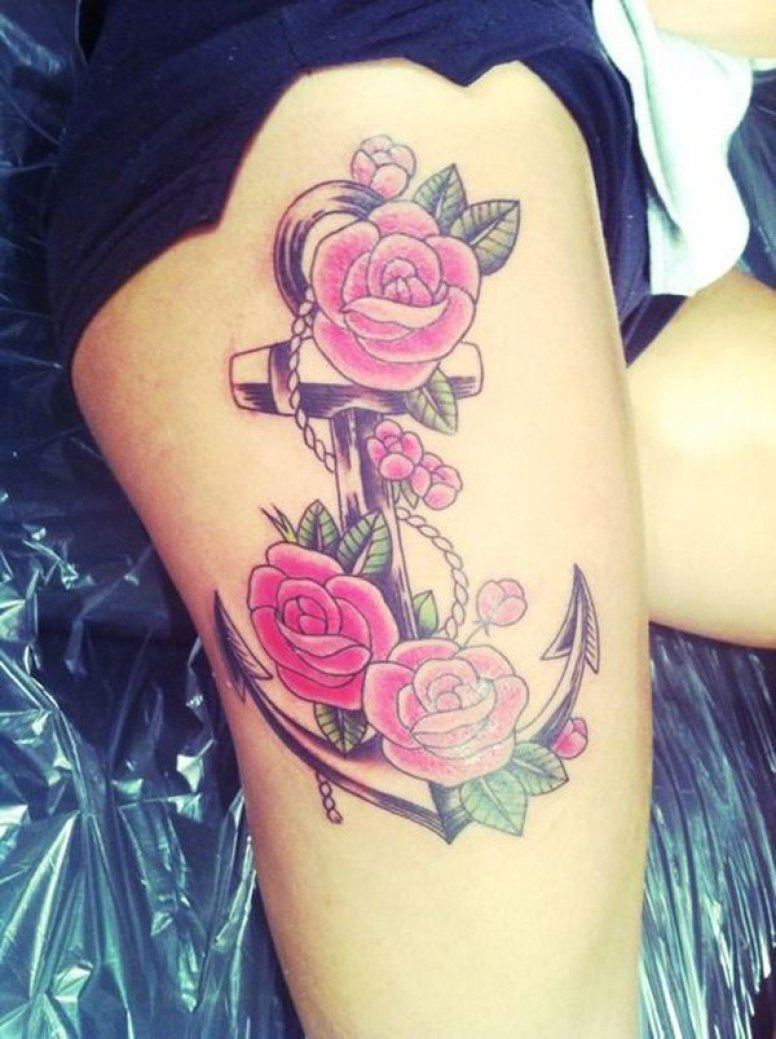 Anchor and flower tattoos