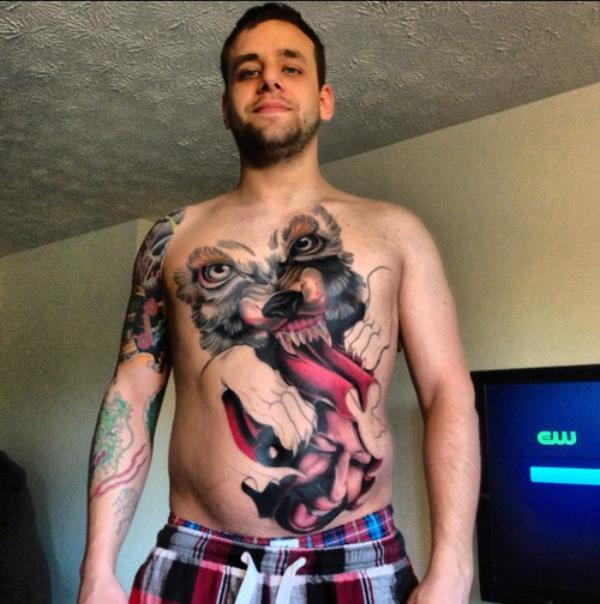 Ripped wolf head tattoo on chest