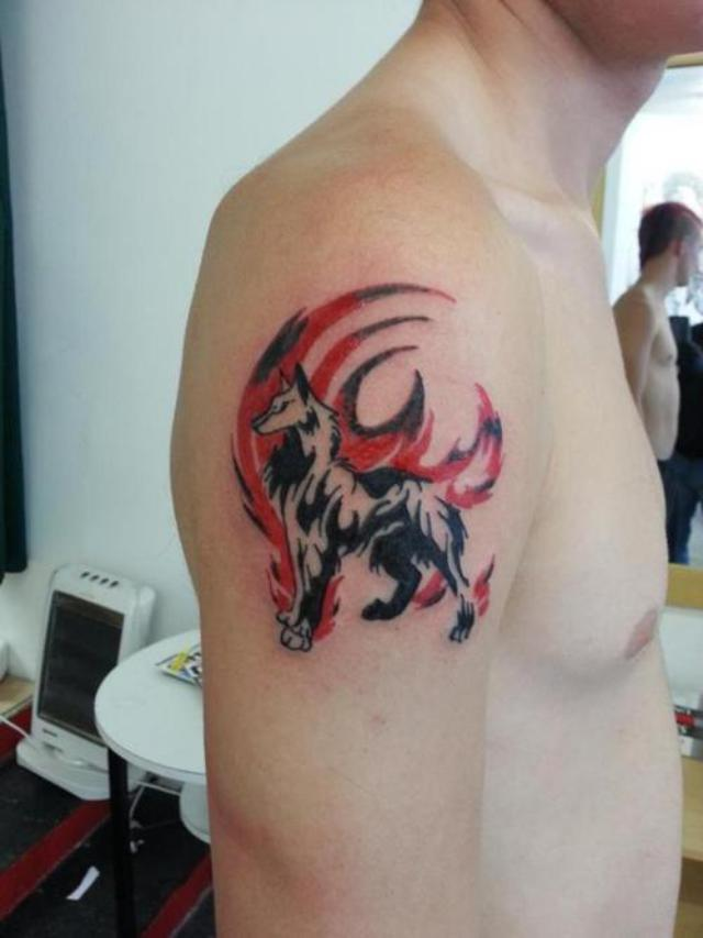 Tribal wolf tattoo design on biceps