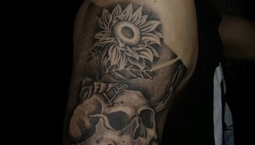 Skull, snake with sunflower tattoo on full sleeve  Skull, Snake with Sunflower Tattoo on Full sleeve skull snake with sunflower tatto