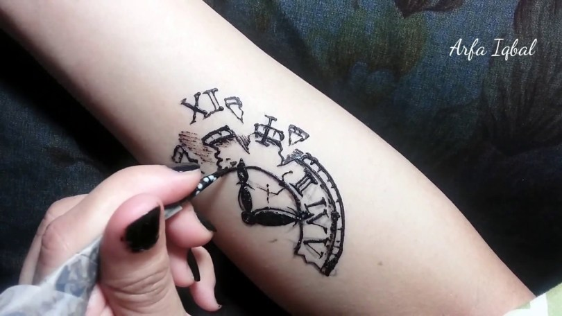 jagua clock tattoo