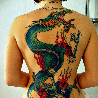 You have to be strong to get a Blue Green Dragon Back Tattoo because not