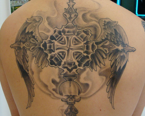 25 Unbelievably Cool Cross Tattoo On Back Slodive Ideas And Designs