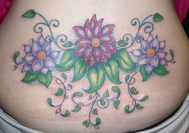 Big Flower Tattoo On Lower Back Ideas And Designs