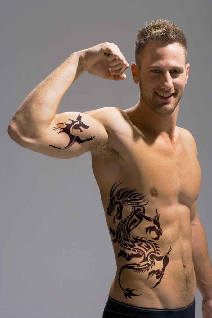 Rib And Bicep Tattoo Design For Men Ideas And Designs