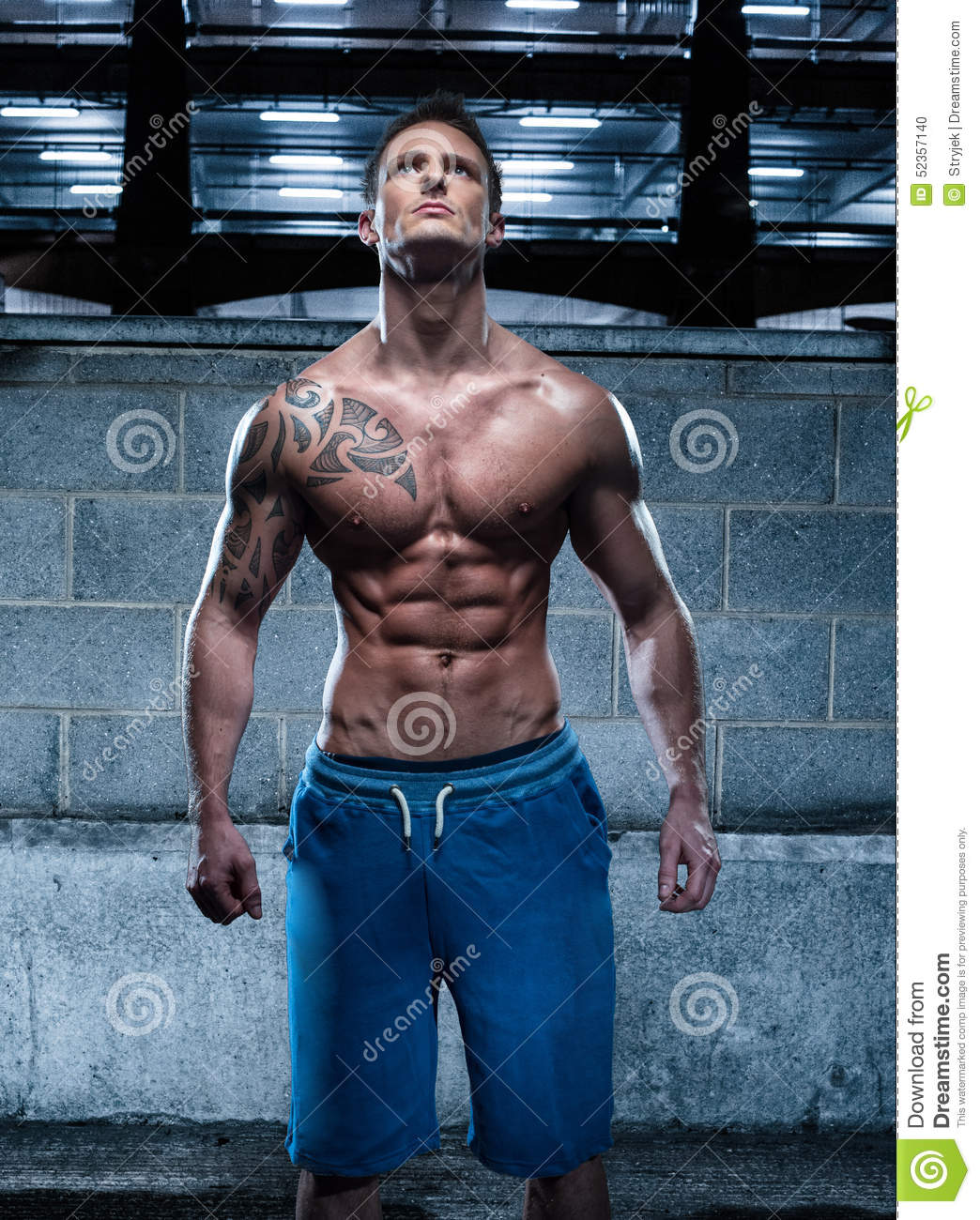 Handsome Athletic Young Man With Tattoo Looking Up Stock Ideas And Designs