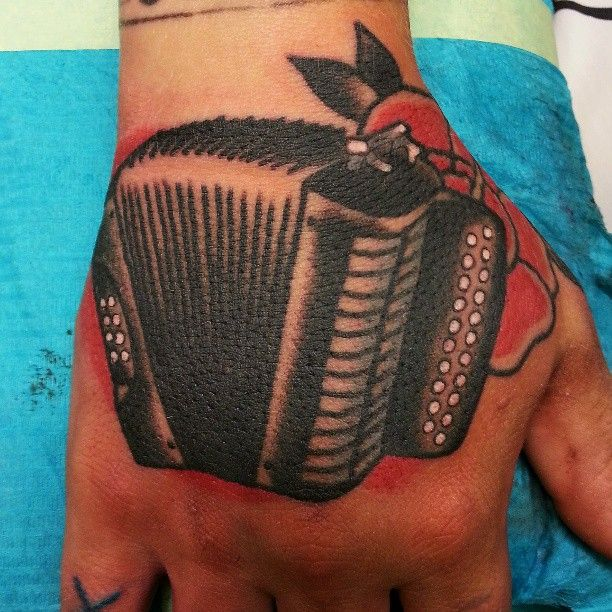 Accordion Hand Tattoo By Hexa Salmela Tattoos That Are Ideas And Designs