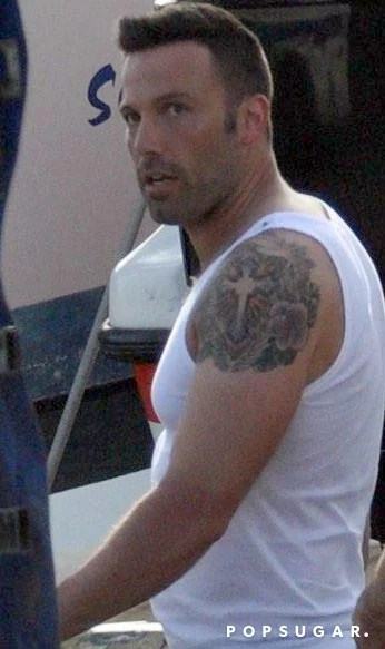 Ben Has A Cross Design With Flowers On His Left Shoulder Ideas And Designs