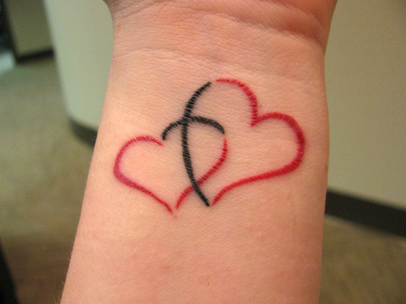 40 Love Tattoos On Wrists Ideas And Designs
