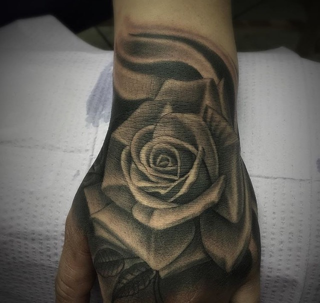 50 Amazing Rose Hand Tattoos Ideas And Designs