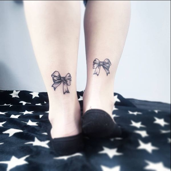 bow matching tattoos on ankle
