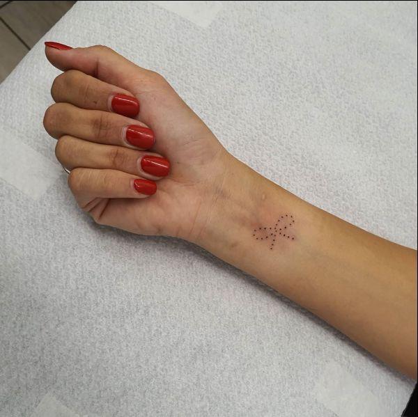 bow tattoo on arm
