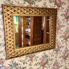 Several wall mirrors in home