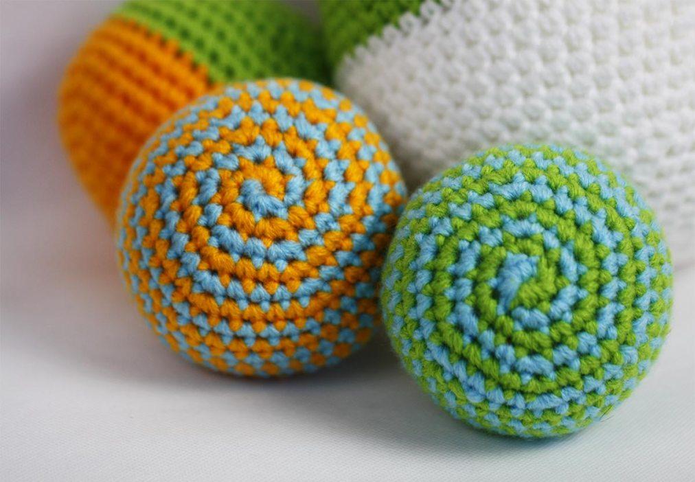 Crochet balls with spiral design.