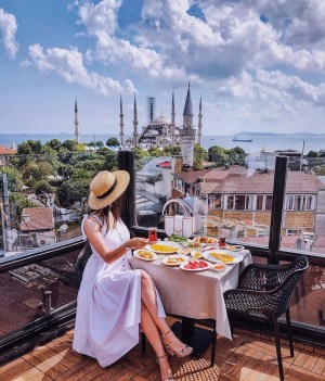 The Blue Mosque, Fatih Istanbul Turkey - Dress, Hat, Mosque, Outdoor furniture, Outdoor table, Person, Restaurant, Table