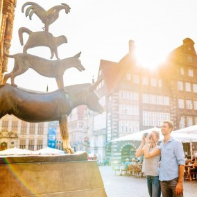 Bremen, Germany - Art, Building, Daytime, Fawn, Happy, Person, Photograph, Sculpture, Shorts, Statue, Window