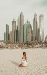 Umm Suqeim Park, Dubai United Arab Emirates - Body of water, Building, Cityscape, Cloud, Daytime, Dress, People in nature, People on beach, Person, Sky, Skyscraper, Tower, Tower block, Travel, Tree